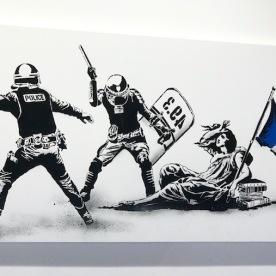 L'Etat matraquant la Liberté by Goin